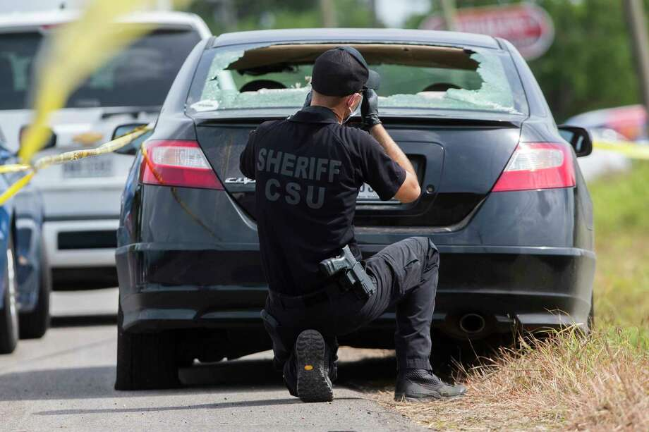 A member of the Fort Bend County Sheriff's Office Crime Scene Unit works the scene of a shooting on Tuesday, July 30, 2019, in Rosenberg. Photo: Marie D. De Jesús, Staff Photographer / © 2019 Houston Chronicle