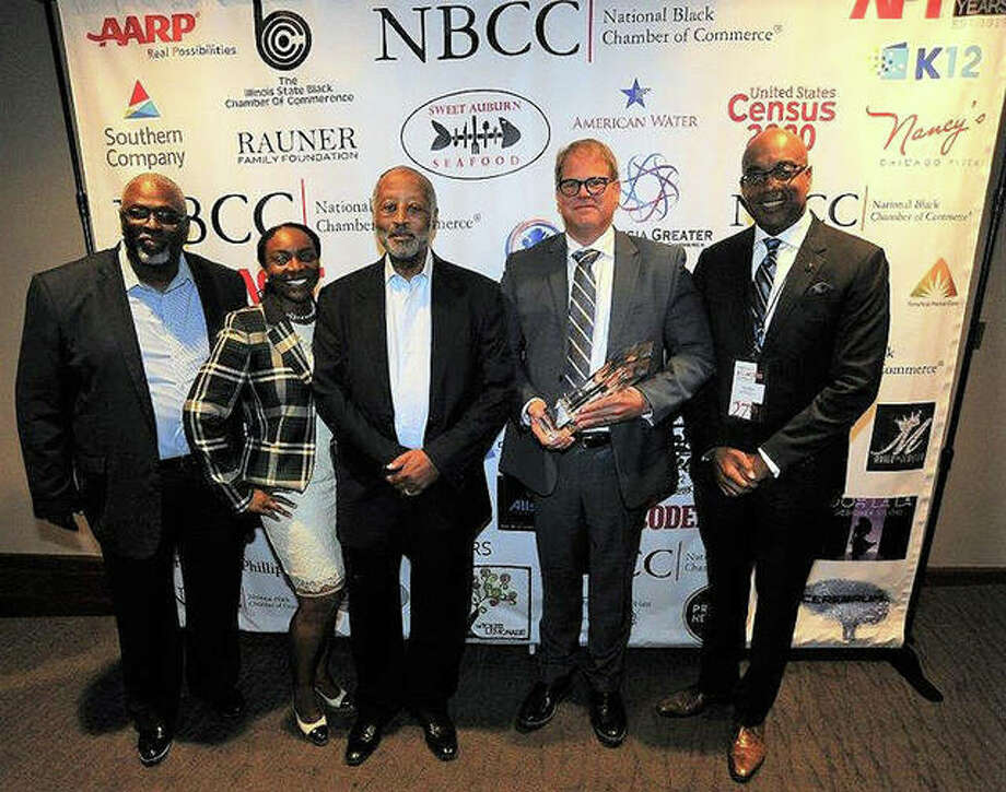 From left, Larry Ivory, President/CEO of the Illinois Black Chamber of Commerce; Rhonda Carter Adams, Illinois American Water Diversity Lead; Harry C. Alford, President/CEO of the National Black Chamber of Commerce; Bruce Hauk, Illinois American Water President; and James F. Clayborne, Jr., former Illinois State Senator. Photo: Courtesy Illinois American Water