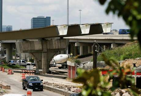 Work continues on a new connector ramp at the Interstate 69 and Loop 610 interchange in Houston on July 11, 2019.