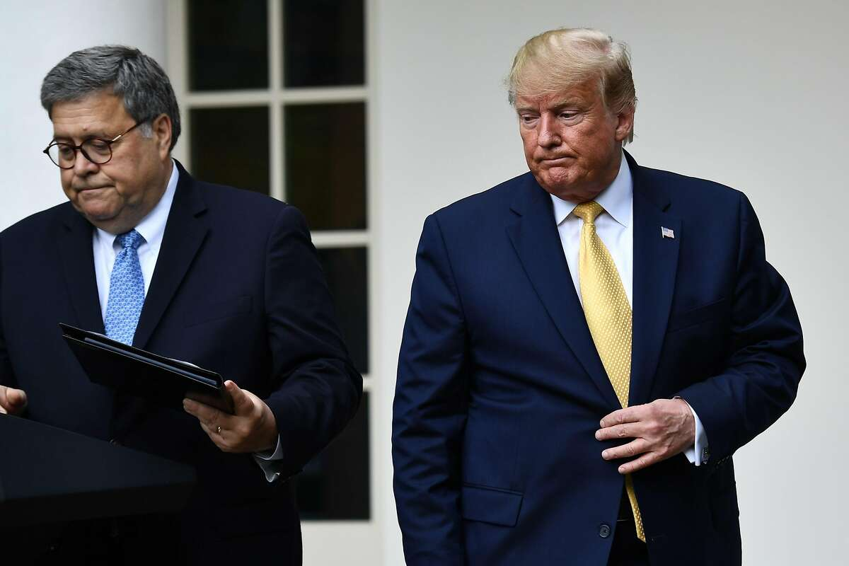 US President Donald Trump (R), flanked by US Attorney General William Barr, arrives to deliver remarks on citizenship and the census in the Rose Garden at the White House in Washington, DC, on July 11, 2019. (Photo by Brendan Smialowski / AFP)BRENDAN SMIALOWSKI/AFP/Getty Images