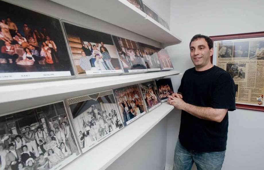 Alexis Vournazos of Danbury with some photos of the shows he has performed in. Photo taken Friday, July 30, 2010 Photo: Scott Mullin / The News-Times Freelance