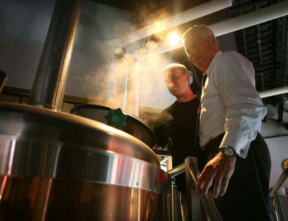 Brewer/manager Frank DelGreco, left, shows Republican governor candidate Oz Griebel the brewing process during a visit to the Southport Brewing Company in Fairfield recently. Photo: Brian A. Pounds / Connecticut Post