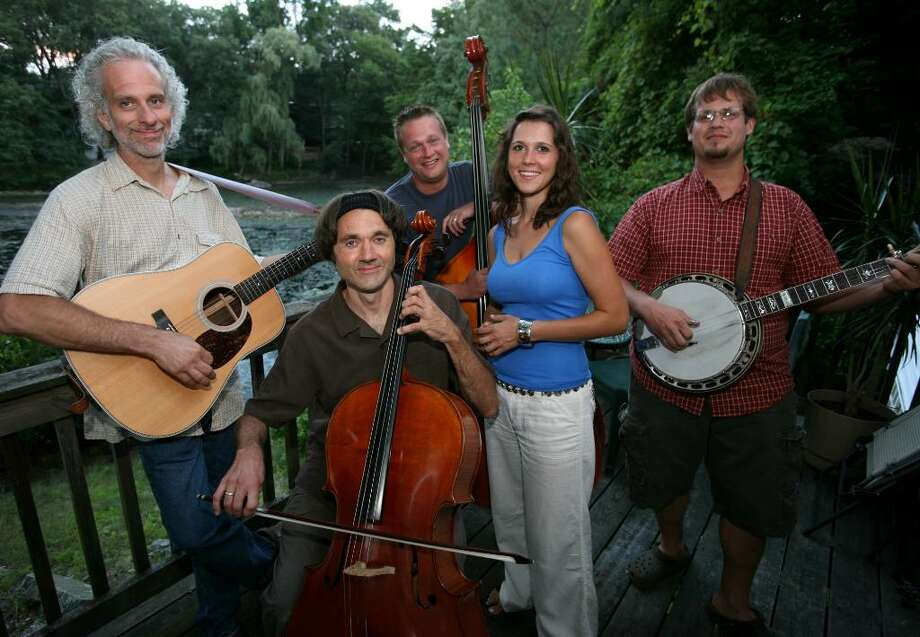 From left; Two Time String Band members Dick Neal of Stratford, Jordan Jancz of Bridgeport, Bob Csugie of Shelton, Katie Neal of Trumbull, and Josh Cohen of Bridgeport, will be performing at the Podunk Bluegrass Festival in East Hartford on August  7 and 8. Photo: Brian A. Pounds / Connecticut Post