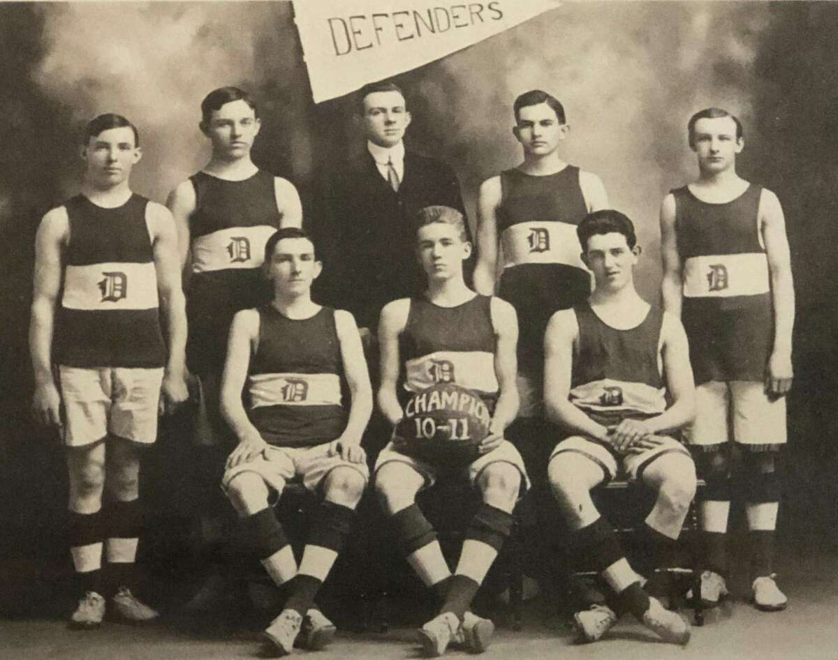 The Defenders basketball team played for many years on the second floor of the town hall in New Milford before the court came to town hall and divided the space to multiple rooms. The 1910-11 team was made up of, from left to right, in front, Michael M. Hastings, James R. Hulton and Victor Moore, and in back, standing, E. Paul Martin, William X. Martin, J. Leo Murphy (player-manager), Martin Manion and Bert Emro. If you have a