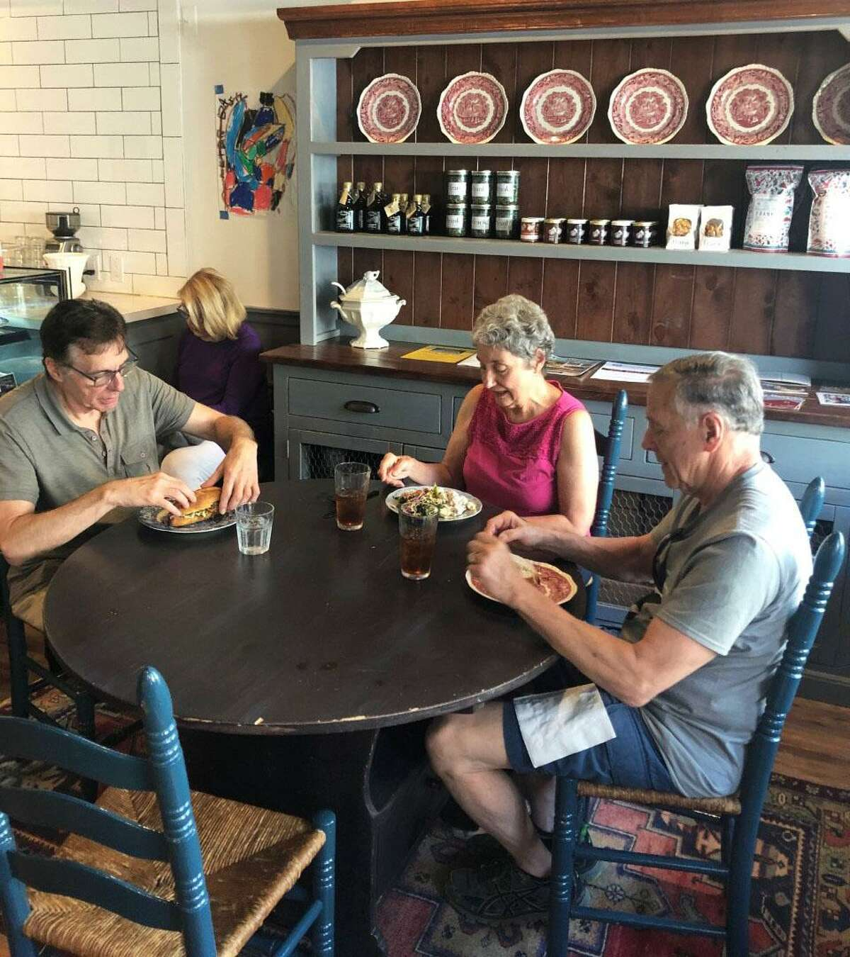 Patrons dine at frank., a shop that opened in May on Main Street in Kent.