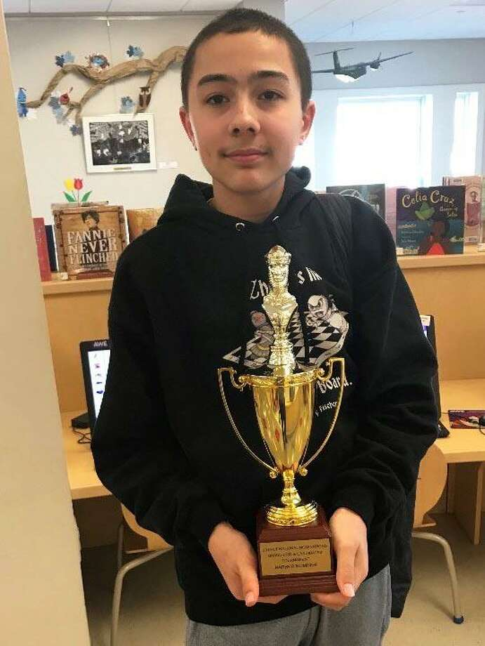 Peter Wolfe, an eighth-grader in New Milford, will compete in the Barber K-8 Chess Championship in Orlando, Fla., this weekend. Peter is shown above after winning the state championship. Photo: Courtesy Of The Wolfe Family / The News-Times Contributed