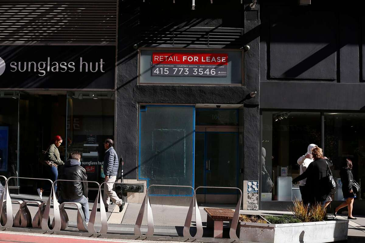 Pedestrians walk by a vacant storefront on Powell Street between Ellis and O'Farrell Streets on Tuesday, January 22, 2019 in San Francisco, Calif.
