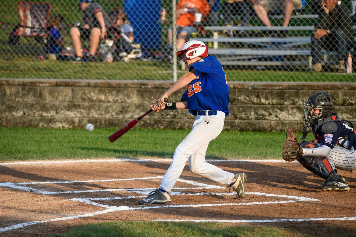 Ethan Klaffer of the Midland Fraternal Northwest Little League junior team swings on a pitch during a game against Macomb Township in the junior state championship final in Grand Rapids on July 29, 2019. (Adam Ferman/for the Daily News)