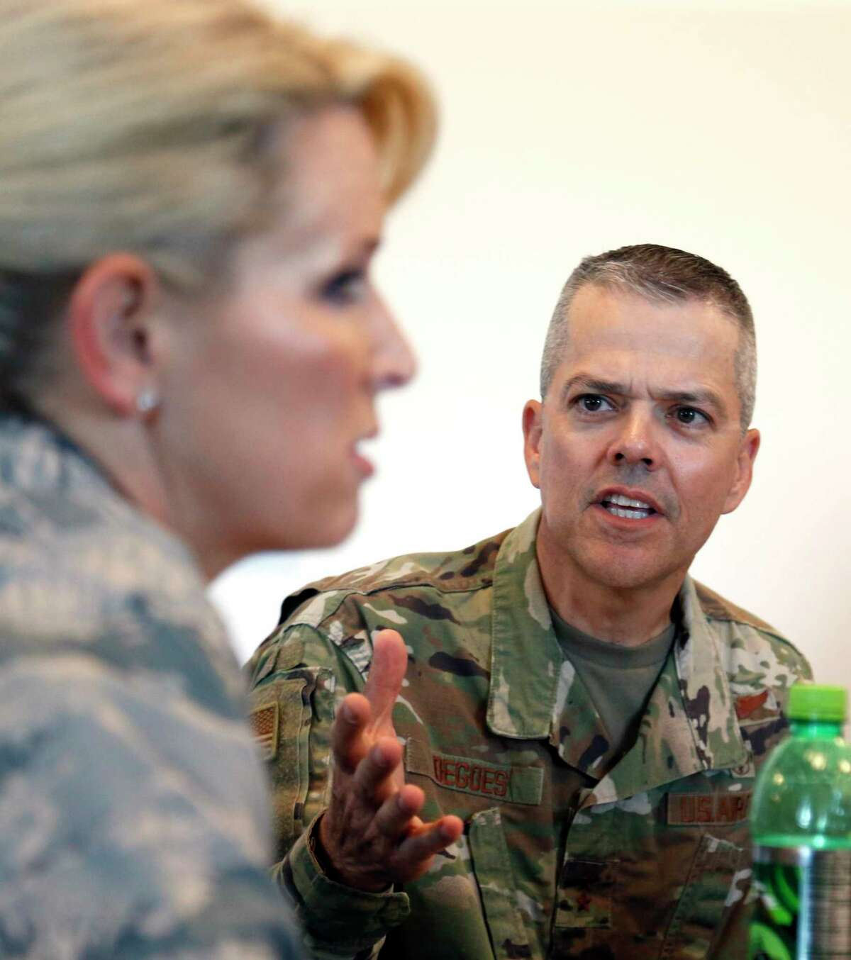 Brig. Gen. Laura Lenderman listens as the commander of the 59th Medical Wing, Maj. Gen. John DeGoes, answers a question as Joint Base San Antonio dealt with mold problems at base housing in 2019. DeGoes is leading efforts to keep COVID-19 cases isolated among Air Force recruits in basic training.