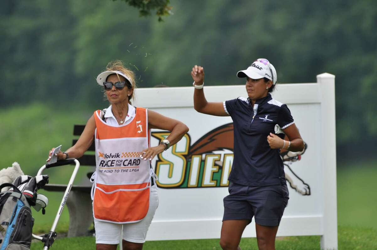 Julieta Granada and her mom/caddie Rosa wait for Granada to tee off on the 18th final hole on the last day of play Sunday, July 28, 2019 of the CDPHP Open at Capital Hills at Albany, the Albany stop for the women's professional Symetra golf tour. The Olympian finished tied for 16th at -7. She is on track to earn an exemption to the LPGA tour for the 2020 season. (Joyce Bassett / Times Union)