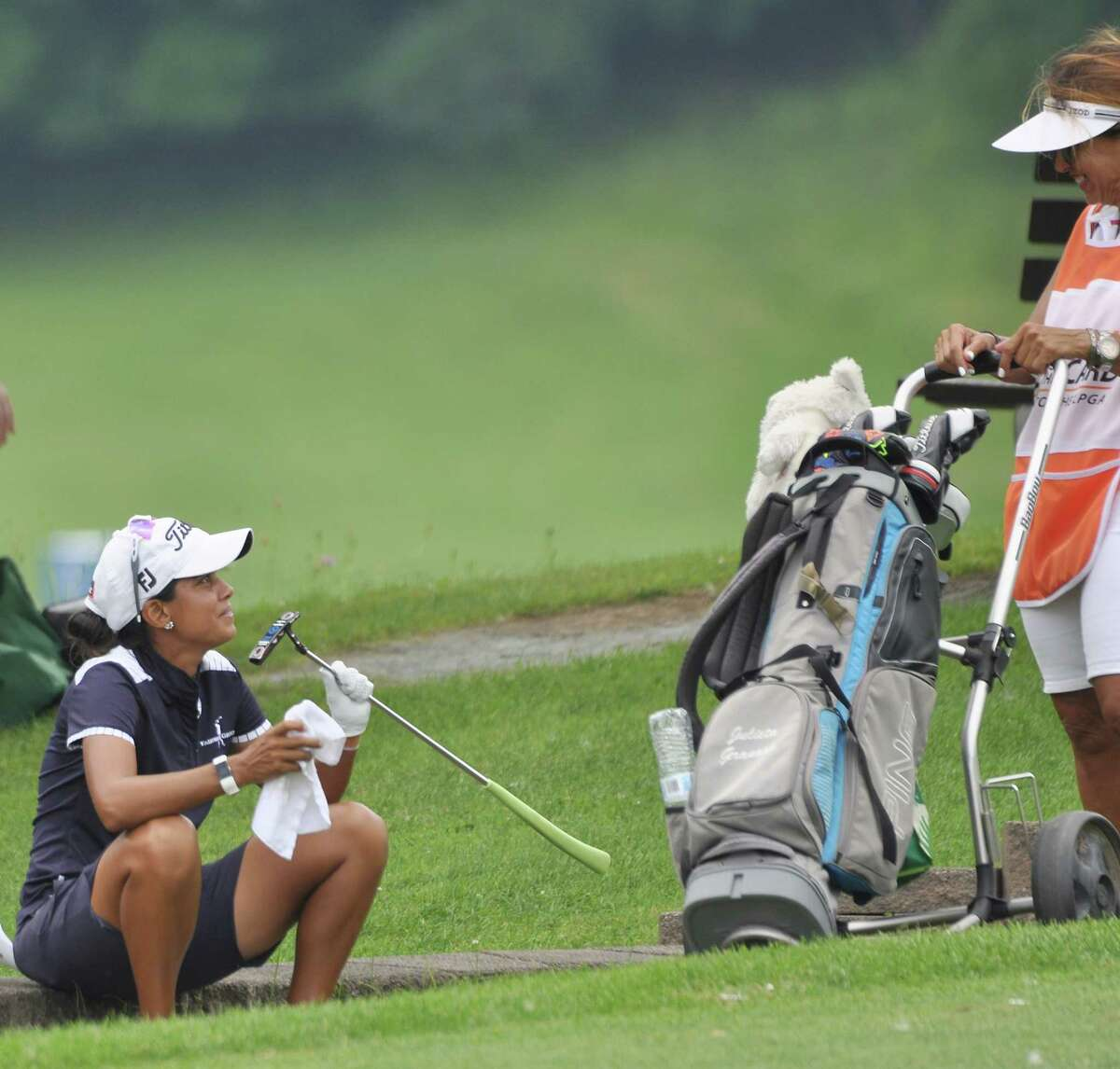 Julieta Granada kisses her putter on the final hole of the CDPHP Open at Capital Hills at Albany, the Albany stop for the women's professional Symetra golf tour, on Sunday, July 28, 2019. She was laughing with her mom/caddie Rosa. The Olympian finished tied for 16th at -7. She is on track to earn an exemption to the LPGA tour for the 2020 season. (Joyce Bassett / Times Union)