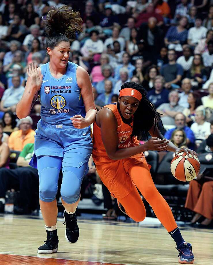 Connecticut Sun center Jonquel Jones drives around Chicago Sky center Stefanie Dolson during Tuesday's game in Uncasville. Photo: Sean D. Elliot / The Day Via AP / 2019 The Day Publishing Company