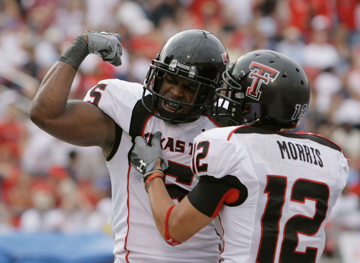 Texas Tech wide receiver Michael Crabtree, left, celebrates with teammate Eric Morris (12) after Crabtree scored his third touchdown against SMU during the third quarter of a football game, Monday, Sept. 3, 2007, in Dallas, Texas. Texas Tech won, 49-9. (AP Photo/Matt Slocum)