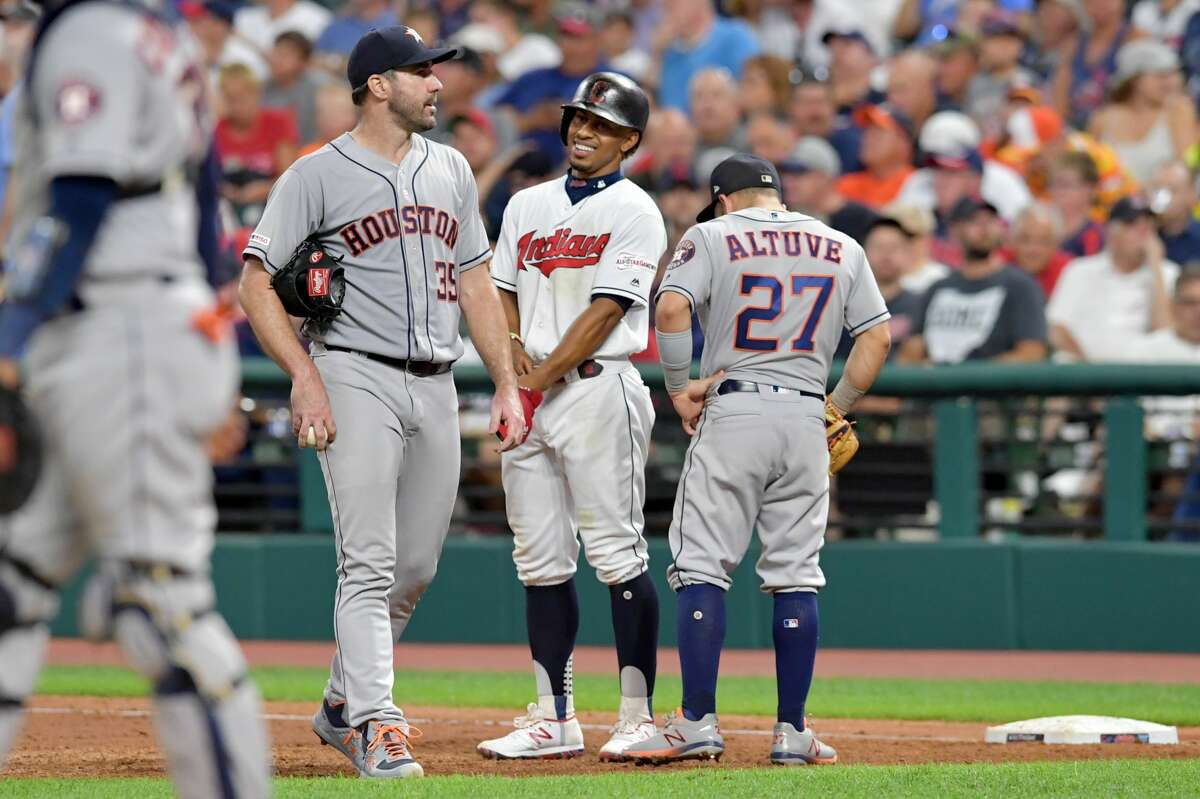 CLEVELAND, OHIO - JULY 30: Starting pitcher Justin Verlander #35 and Jose Altuve #27 of the Houston Astros talk with Francisco Lindor #12 of the Cleveland Indians on first during an instant replay challenge during the sixth inning at Progressive Field on July 30, 2019 in Cleveland, Ohio. (Photo by Jason Miller/Getty Images)