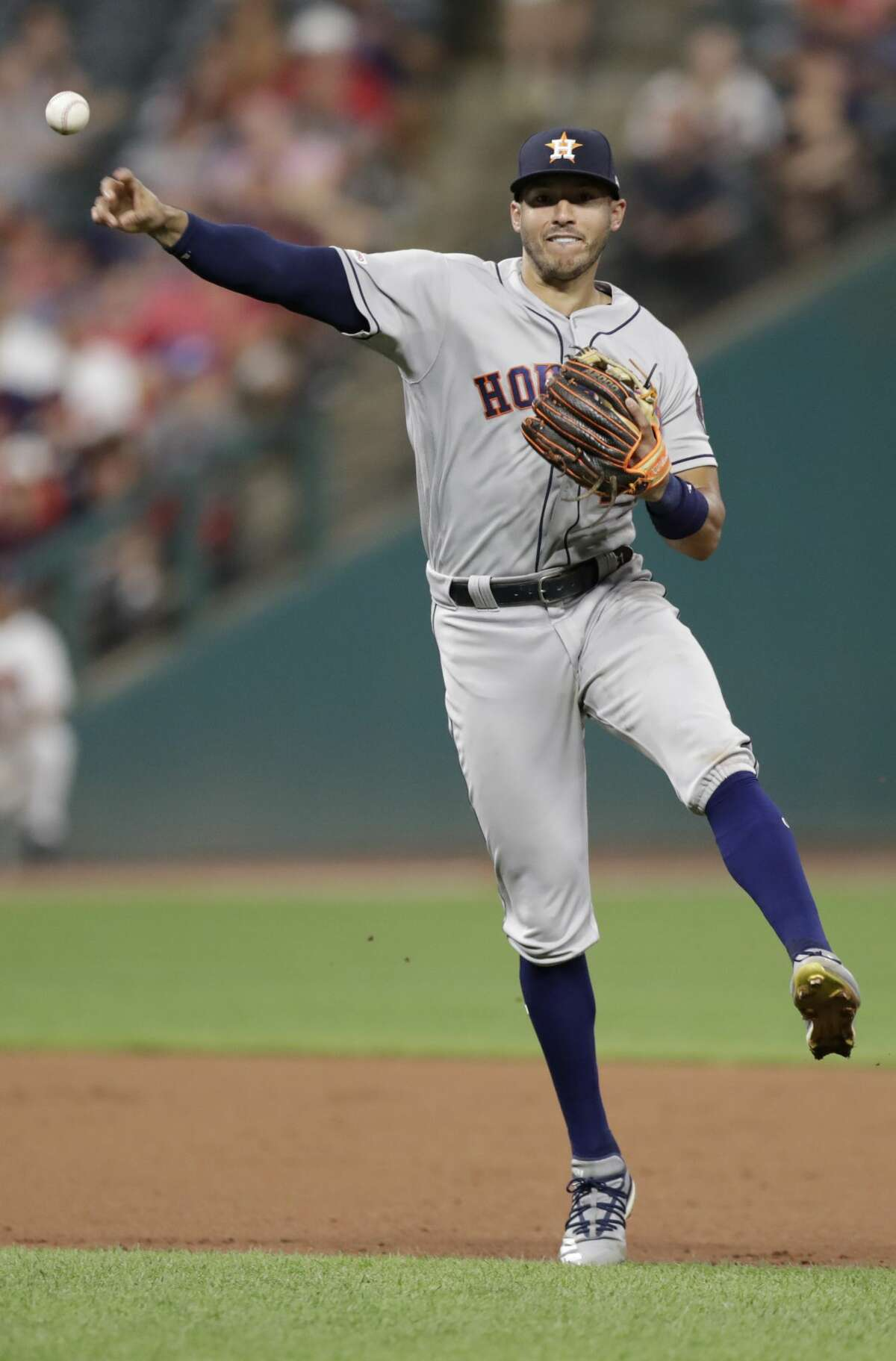 Houston Astros Carlos Correa throws out Cleveland Indians' Oscar Mercado at first base in the ninth inning of a baseball game, Tuesday, July 30, 2019, in Cleveland. The Astros won 2-0. (AP Photo/Tony Dejak)