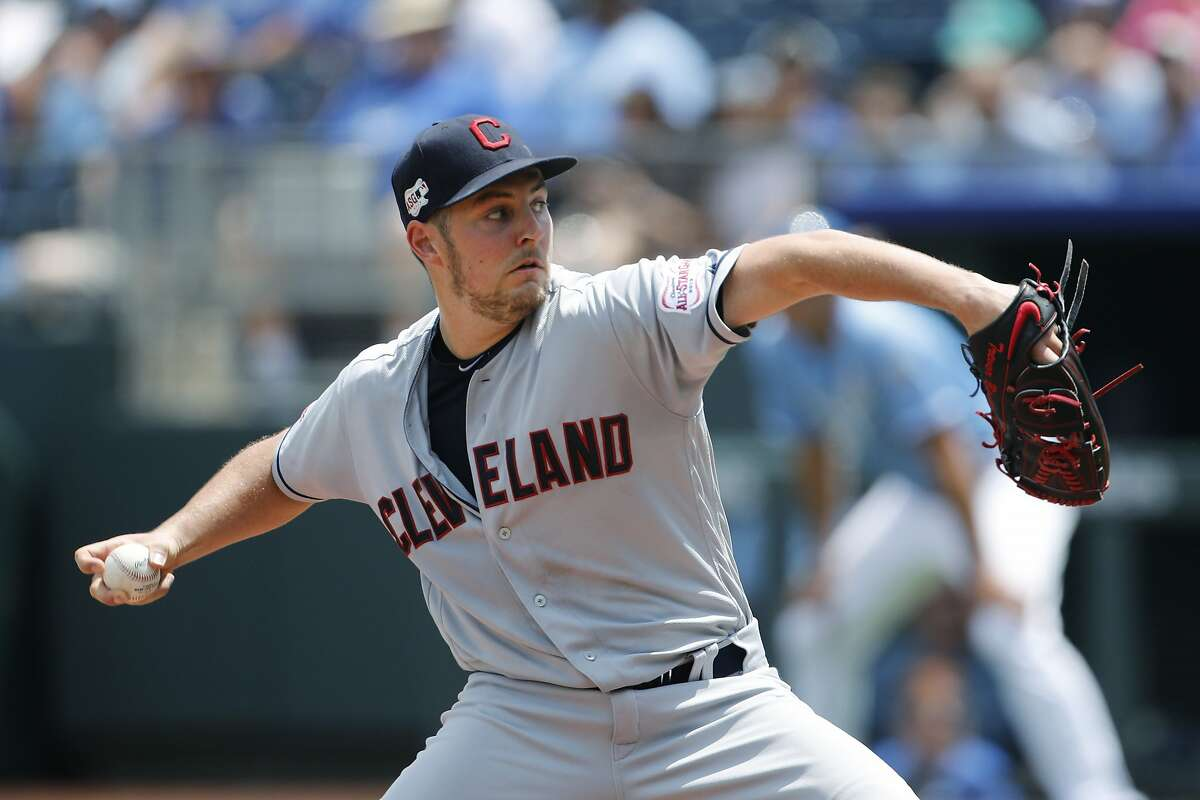 Cleveland Indians pitcher Trevor Bauer throws against the Kansas City Royals in the first inning of a baseball game at Kauffman Stadium in Kansas City, Mo., Sunday, July 28, 2019. (AP Photo/Colin E. Braley)