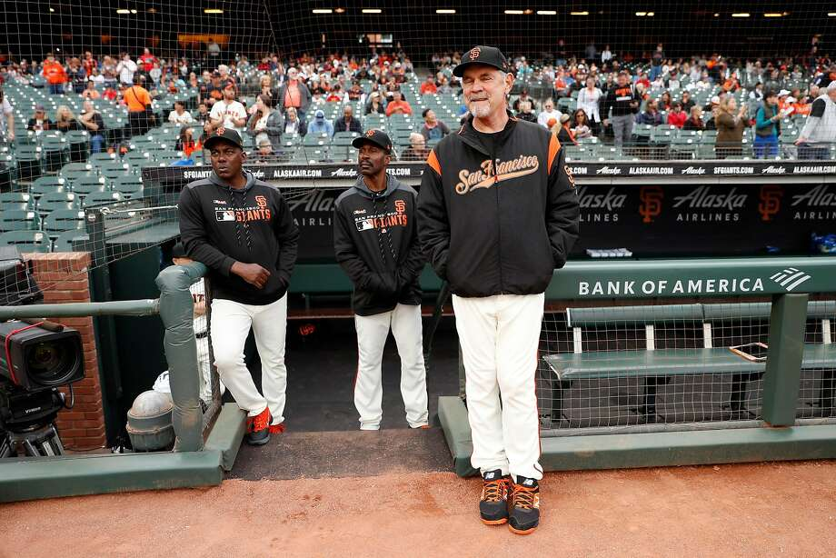 Giants manager Bruce Bochy and coaches Hensley Meulens, left, and Shawon Dunston, center, soak in the scene before a July 18 home game. Photo: Scott Strazzante / The Chronicle