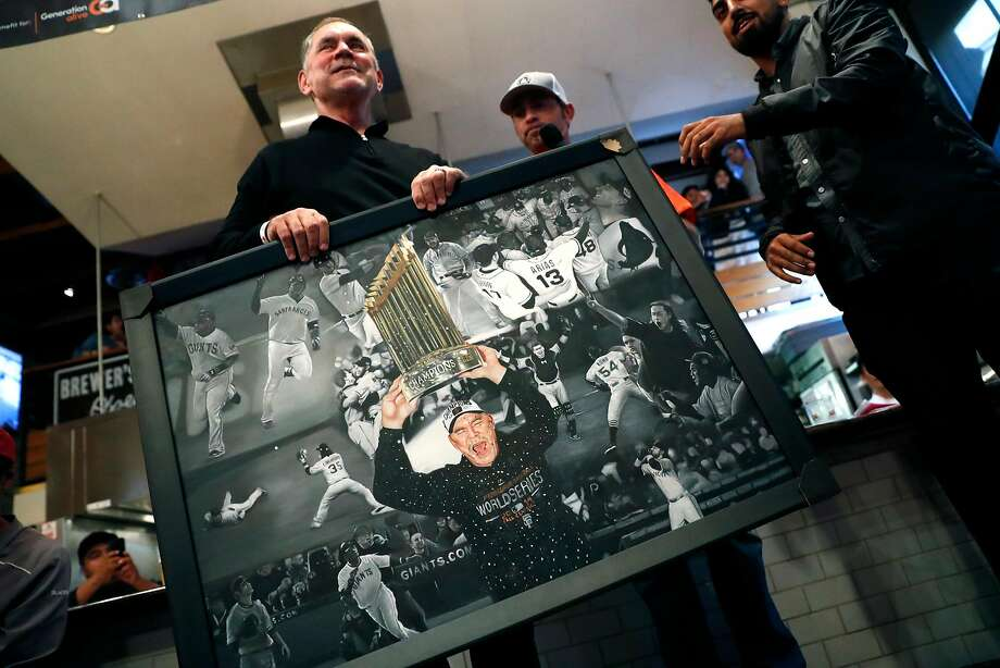 Bruce Bochy is presented a photo collage during the Jeremy Affeldt & Friends Charity Bash at 21st Amendment Brewery in San Francisco on July 21. Photo: Scott Strazzante / The Chronicle