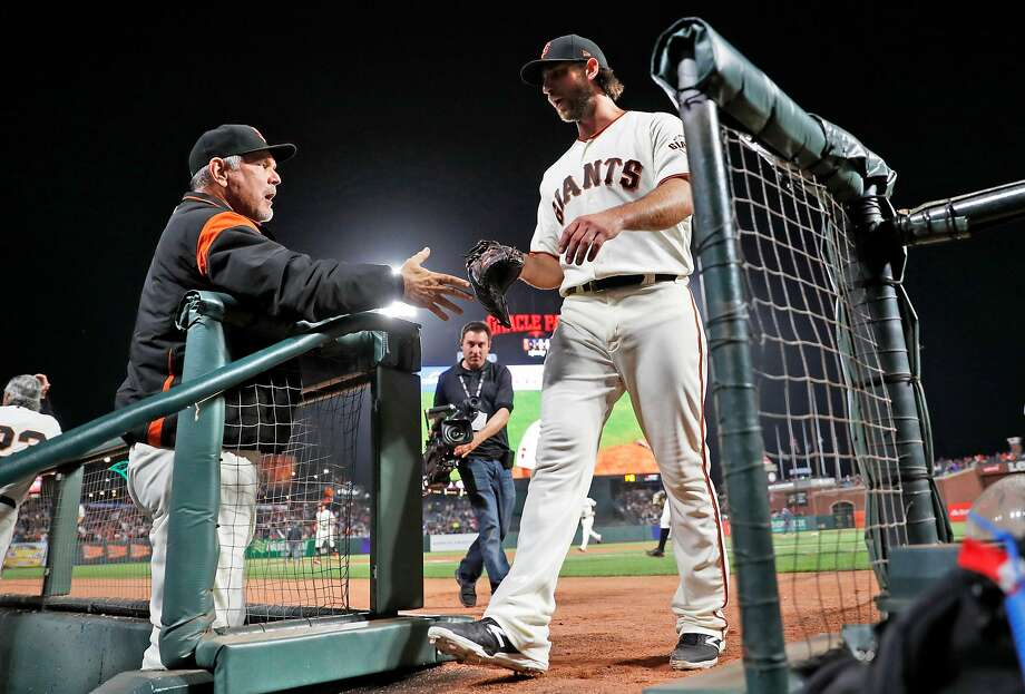 San Francisco Giants' Madison Bumgarner is welcomed back to the dugout by manager Bruce Bochy after retiring the New York Mets in the 9th inning during Giants' 16 inning win in MLB game at Oracle Park in San Francisco, Calif., on Thursday, July 18, 2019. Photo: Scott Strazzante / The Chronicle