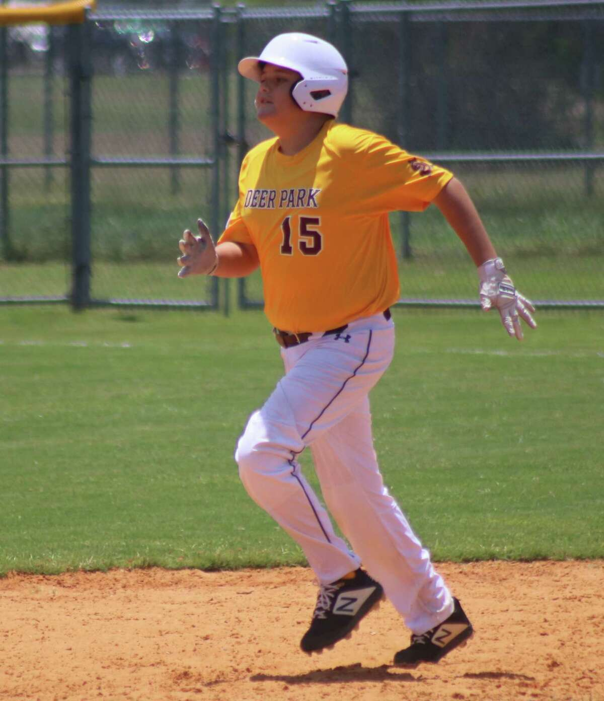 Maddox Atchley jogs into second base after hitting a double during this past weekend's Bronco South Zone Tournament. Less than four months after having brain surgery, Maddox helped Deer Park earn the No. 2 seed after two days of pool play.