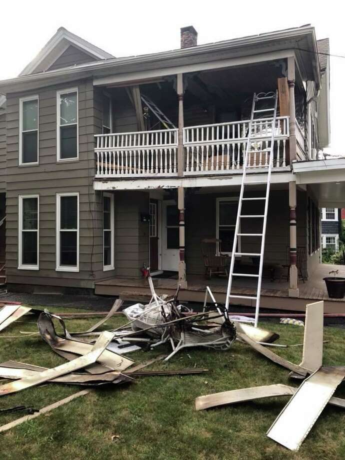 One person was injured during a porch fire that damaged a two-story home on Main Street Tuesday evening on July 30, 2019, firefighters said. The blaze at 325 Main St. was called in at about 7:10 p.m. as a fire on a side porch of the multi-family home, the Torrington Fire Department said. Photo: Joe Mac Photo Via Torrington Fire Department Facebook