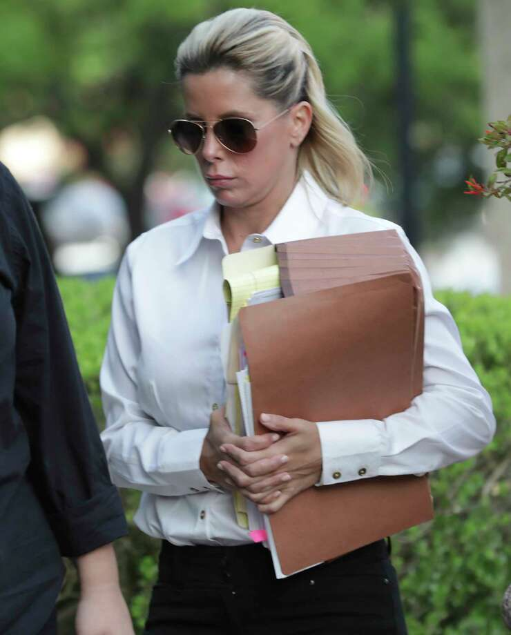 Holly Blakely, 45, arrives at the Federal Courthouse on Tuesday, July 30, 2019, to be sentence for her involvement in an $8.8 million health care fraud scheme that earned her more than $1 million. Photo: Bob Owen, Staff Photographer / ©2019 San Antonio Express-News