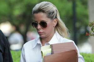 Holly Blakely, 45, arrives at the Federal Courthouse on Tuesday, July 30, 2019, to be sentence for her involvement in an $8.8 million health care fraud scheme that earned her more than $1 million.