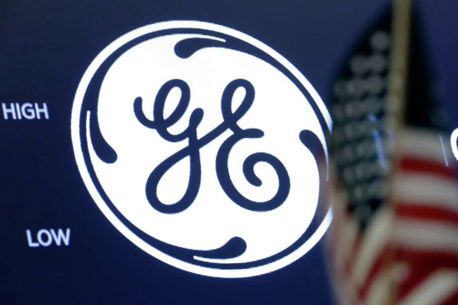 In this June 26, 2018, file photo the General Electric logo appears above a trading post on the floor of the New York Stock Exchange. General Electric Co. reports financial results on Wednesday, July 31. Photo: Richard Drew / Associated Press / AP