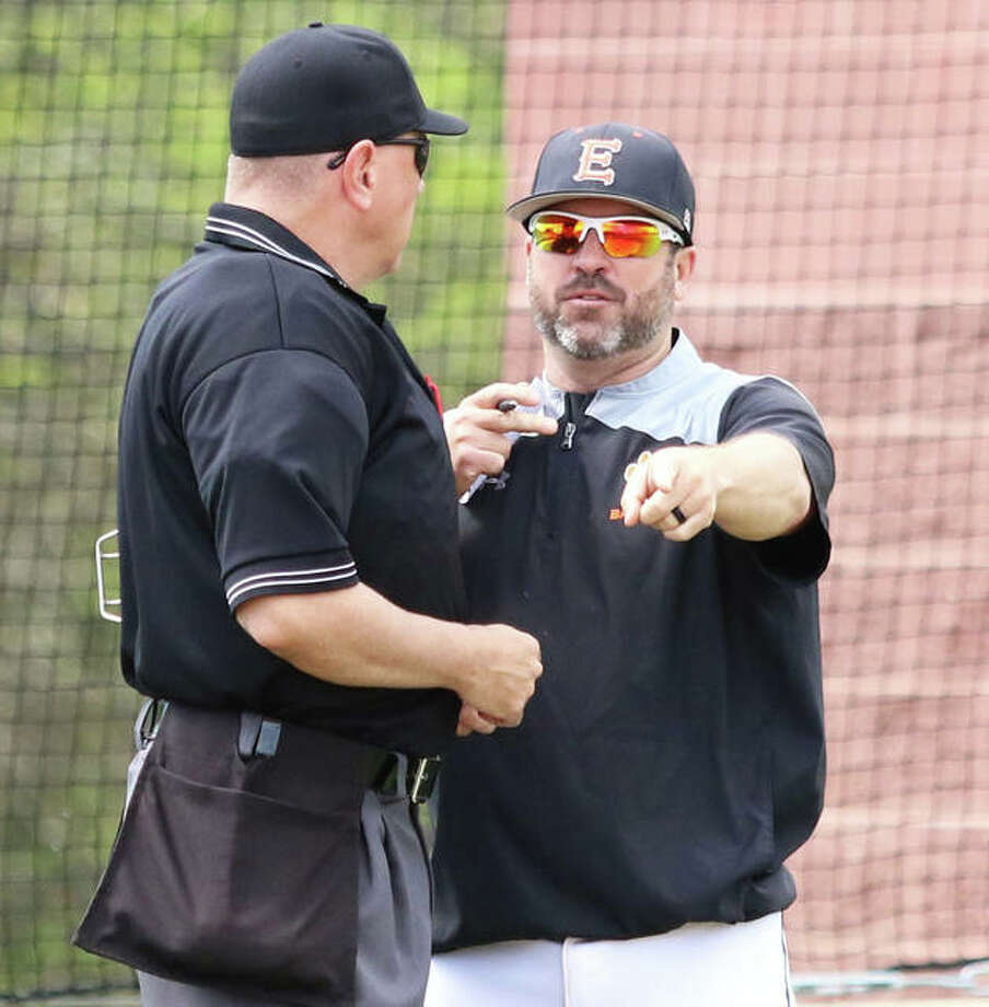 Edwardsville coach Tim Funkhouser (right), shown making a point to the plate umpire during a game at Alton High on April 22, is the 2019 Telegraph Large-Schools Baseball Player of the Year. Photo: Greg Shashack / The Telegraph