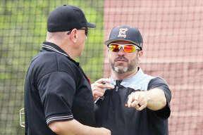 Edwardsville coach Tim Funkhouser (right), shown making a point to the plate umpire during a game at Alton High on April 22, is the 2019 Telegraph Large-Schools Baseball Player of the Year.