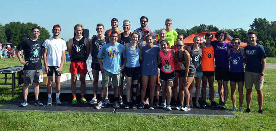 Edwardsville High School cross country alumni gather for a photo after Saturday's Mud Mountain 5K at the SIUE and EHS cross country course.