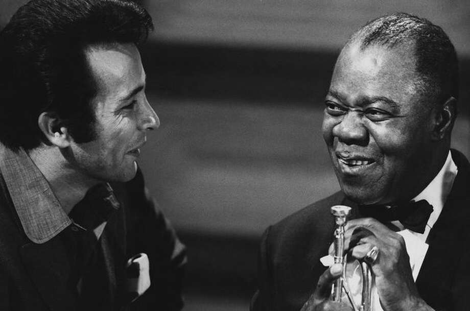 Herb Albert, left, and Louis Armstrong in the 1960s. (Getty Images)