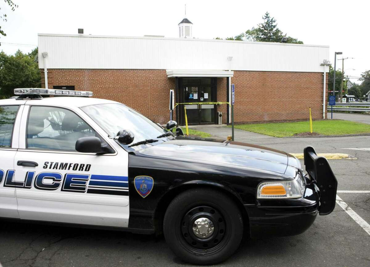 A police cruiser sits behind Wachovia Bank branch on Hope Street in Stamford after a possible robbery attempt. Kerry Sherck
