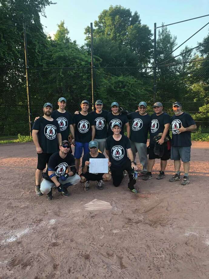 Started after a Facebook post, the Ridgefield Fathers Club softball team gathers for a post-game photo. Back row (left to right): Justin DiGrazia, Adrian Thibodeau, Jason Smith, Paul Dyer, Ed Winstanley, Aaron Lockwood, Joe Attonito, Tony Grau; bottom row: Charlie Taney, Mike Schmer, Dave Parsons. Photo: Contributed Photo / Charlie Taney