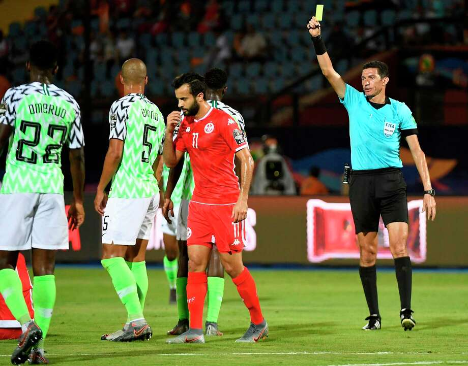 An Egyptian refereee shows a yellow card to Nigerian defender during a recent international soccer game. Photo: KHALED DESOUKI / AFP /Getty Images / AFP or licensors
