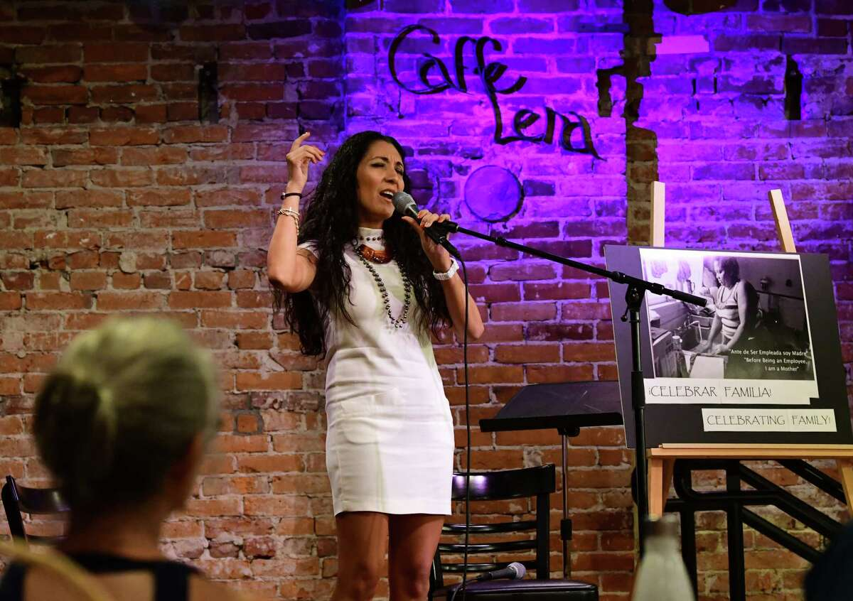 Performance artist Ericka O'Donnell sings a song during Immigrant Stories: In Their Own Words series held at Caffe Lena on Tuesday, July 31, 2019 in Saratoga Springs, N.Y. (Lori Van Buren/Times Union)