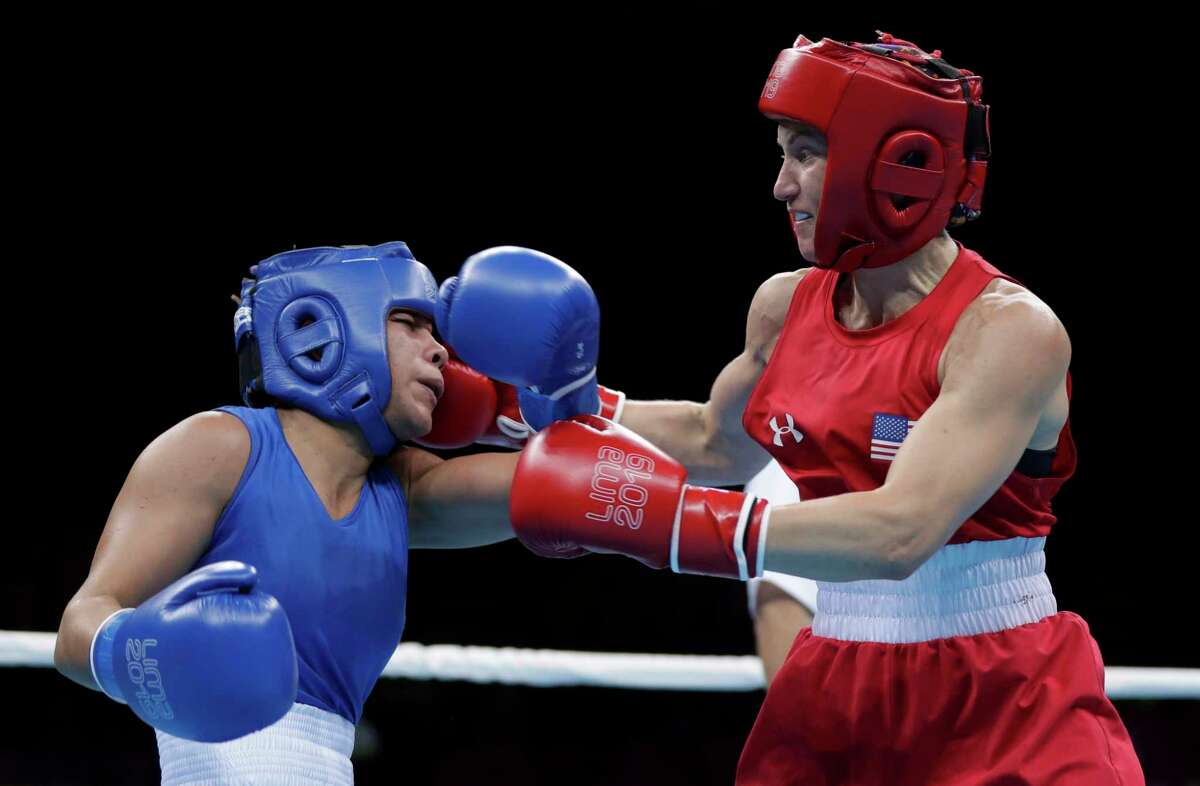 Virginia Fuchs of the United States, right, throws a punch at Irismar Cardozo of Venezuela during the second round of their women's fly, 51 kg boxing semifinal bout at the Pan American Games in Lima, Peru, Tuesday, July 30, 2019. (AP Photo/Fernando Llano)