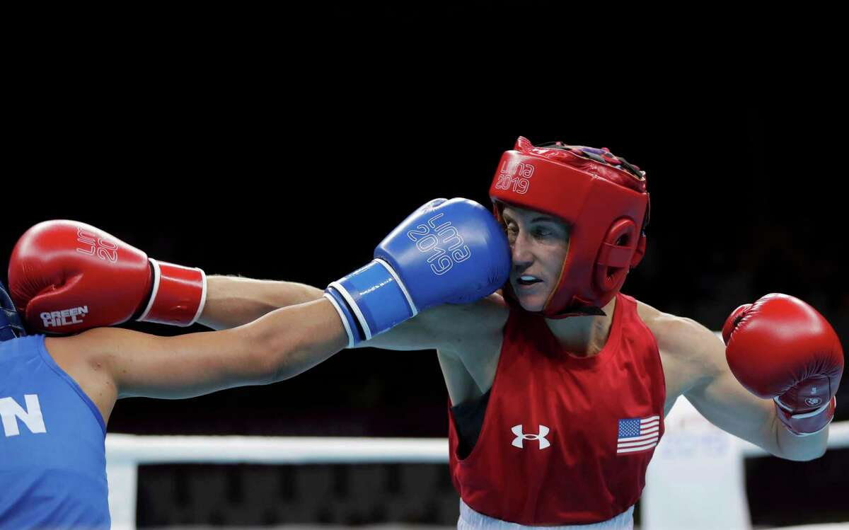 Virginia Fuchs of the United States, right, takes a punch from Irismar Cardozo of Venezuela during the second round of their women's fly, 51 kg, boxing semifinal bout at the Pan American Games in Lima, Peru, Tuesday, July 30, 2019. (AP Photo/Fernando Llano)