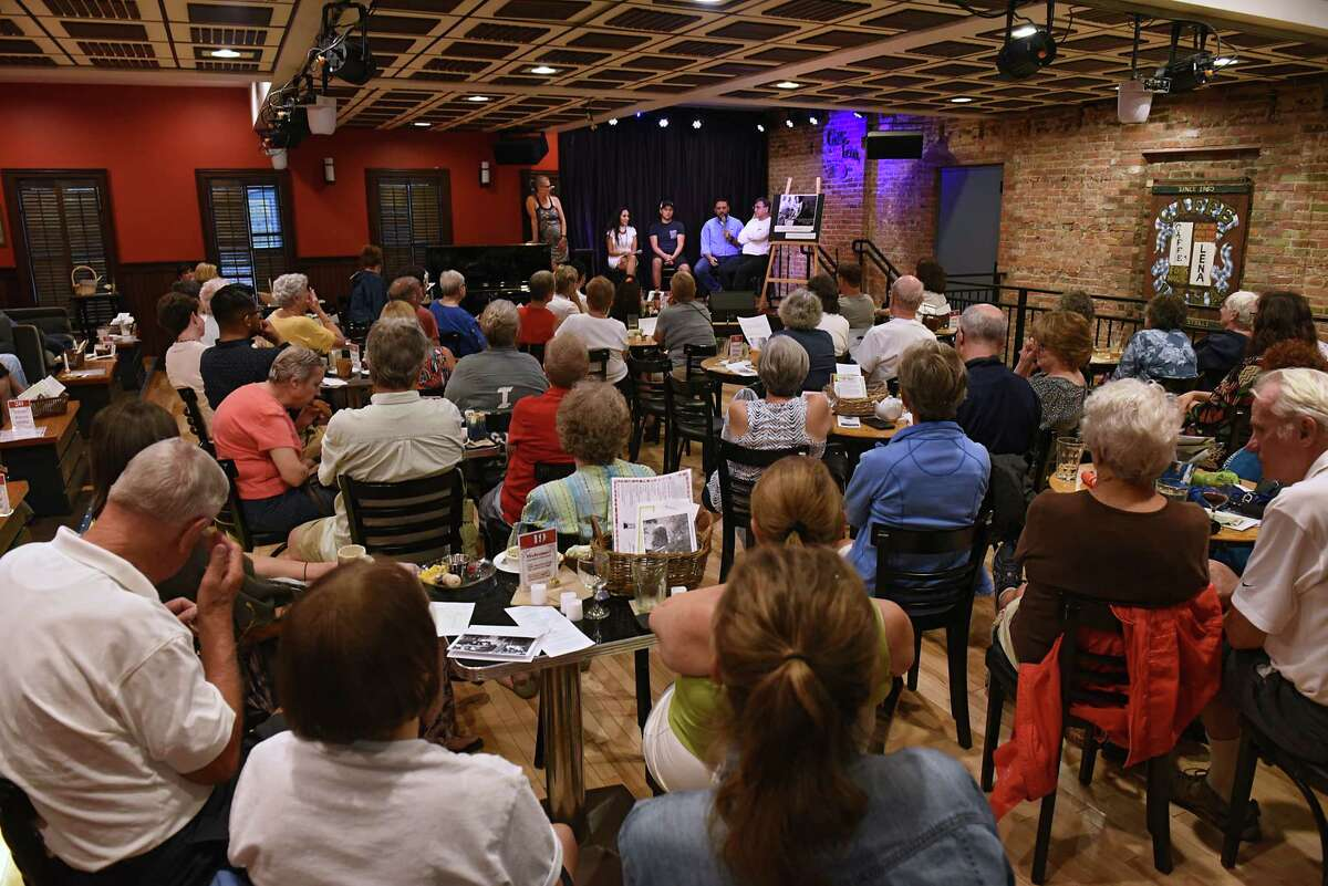 From left, Maxine Lautenburg of Saratoga Immigration Coalition, performance artist Ericka O'Donnell, groom Angelo Acosta of Peru, Chaplain Humberto Chavez of Mexico and exercises rider Marco Acosta of Peru take turns speaking during Immigrant Stories: In Their Own Words series held at Caffe Lena on Tuesday, July 31, 2019 in Saratoga Springs, N.Y. (Lori Van Buren/Times Union)