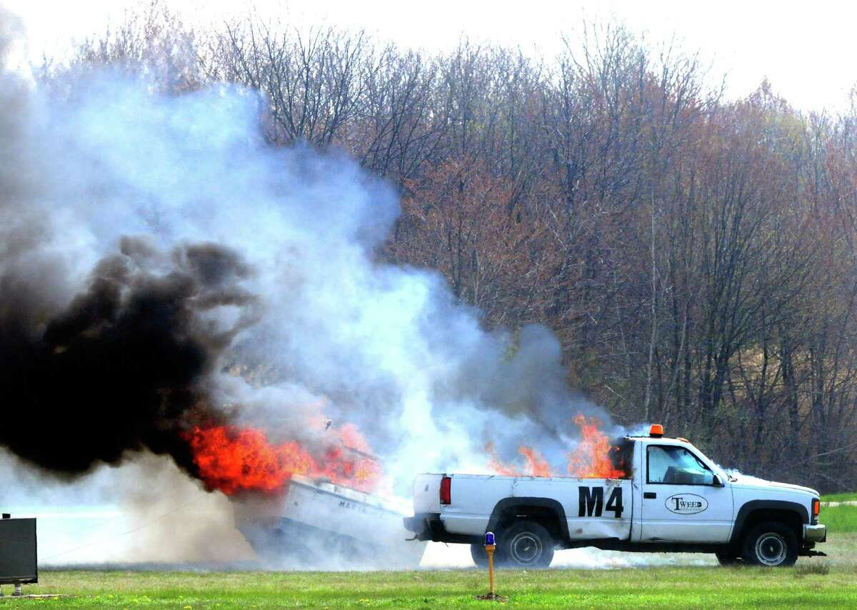 A fire burns following an explosion at the start of the Triennial Disaster Drill at Tweed New Haven Regional Airport in 2011.