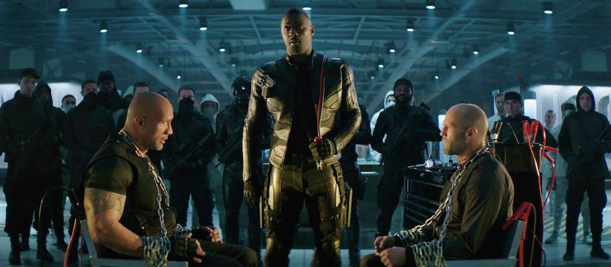 """This image released by Universal Pictures shows, foreground from left, Dwayne Johnson, Idris Elba and Jason Statham in a scene from """"Fast & Furious Presents: Hobbs & Shaw."""" (Universal Pictures via AP)"""