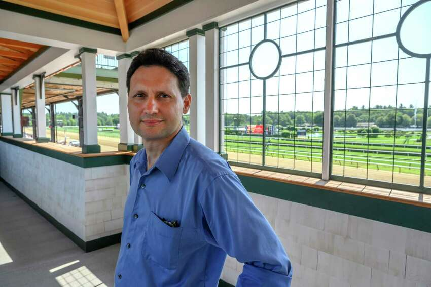 Architect Mathew Hurff stands near one of his projects, the bridge from the old clubhouse to the 1863 Club Thursday July 25, 2019at the Saratoga Race Course in Saratoga Springs, N.Y. Photo Special to the Times Union by Skip Dickstein