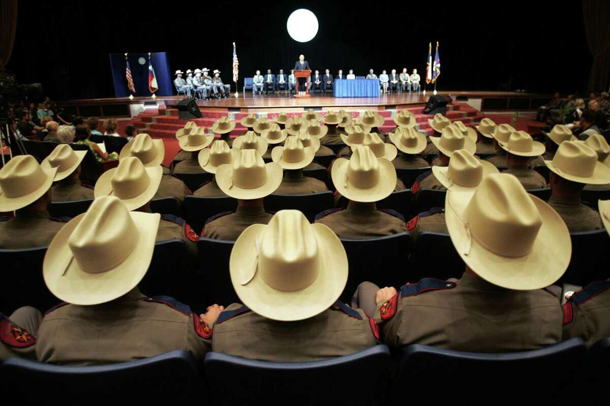 One-hundred twenty new state troopers listen to Col. Thomas A. Davis, Jr., director of the Texas Department of Public Safety Recruit School give closing remarks during the graduation ceremony at Shoreline Christian Center in Austin, Texas Friday, Aug. 5, 2005. (AP Photo/The Dallas Morning News, Erich Schlegel)