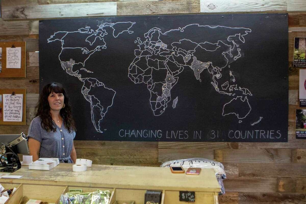 Mercy House Global founder Kristen Welch stands behind the shop counter Tuesday, July 30, 2019 at Mercy House Global Market in Magnolia.