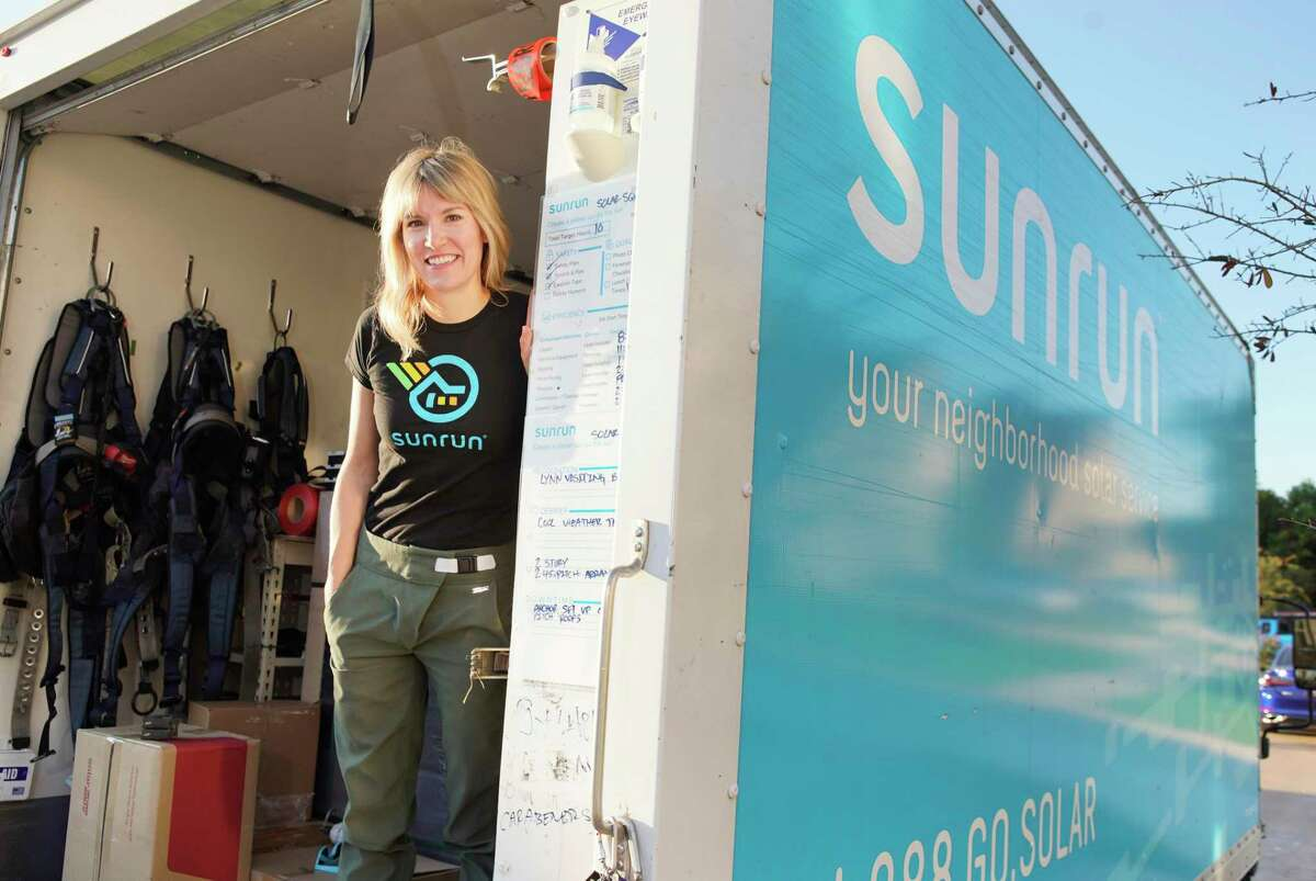 Lynn Jurich, CEO of Sunrun, stands in a truck at a job site Thursday, July 25, 2019, in Sugar Land.