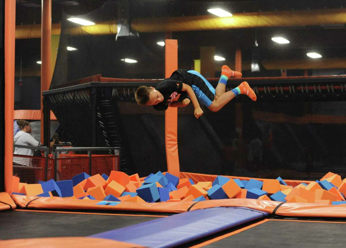 A Sky Zone Bethel patron flips into a foam pit in August 2014.