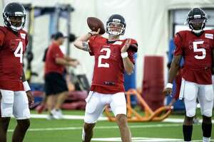 Houston Texans quarterback AJ McCarron (2) throws a pass during training camp at the Methodist Training Center on Wednesday, July 31, 2019, in Houston.