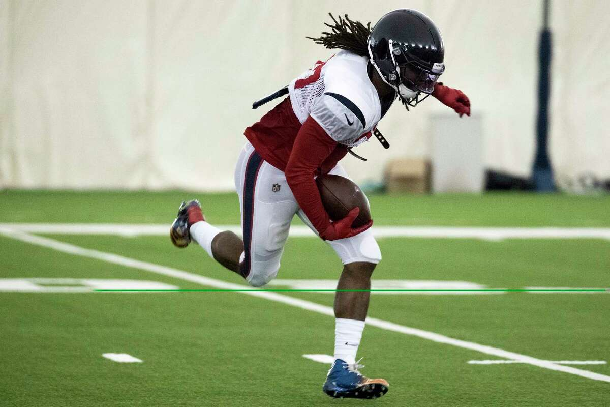 Houston Texans running back D'Onta Foreman runs with the ball during training camp at the Methodist Training Center on Wednesday, July 31, 2019, in Houston.