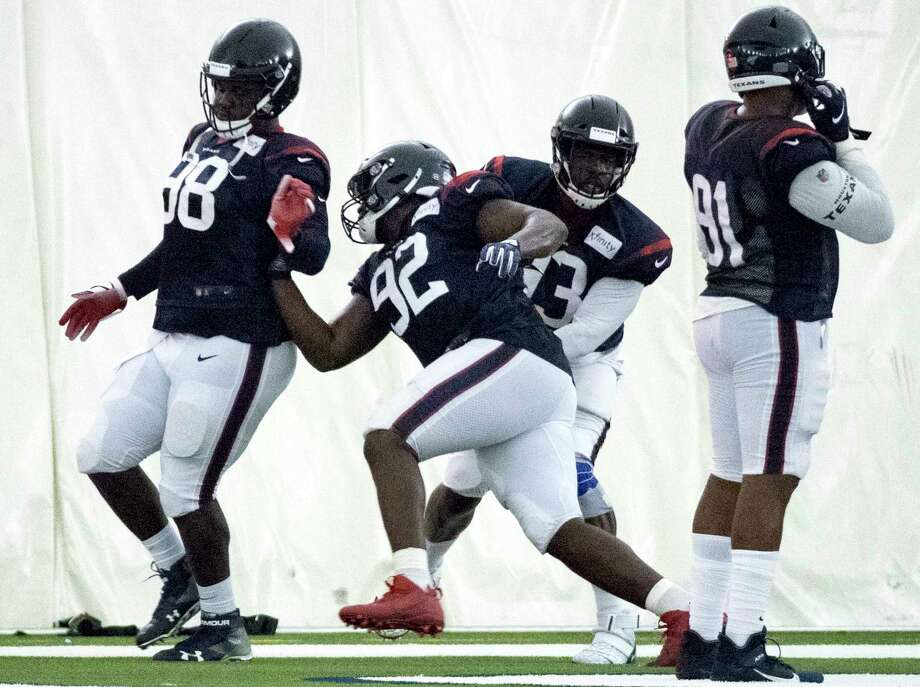 Houston Texans nose tackle Brandon Dunn (92) runs a drill against defensive ends D.J. Reader (98) and Joel Heath (93) during training camp at the Methodist Training Center on Wednesday, July 31, 2019, in Houston. Photo: Brett Coomer, Staff Photographer / © 2019 Houston Chronicle