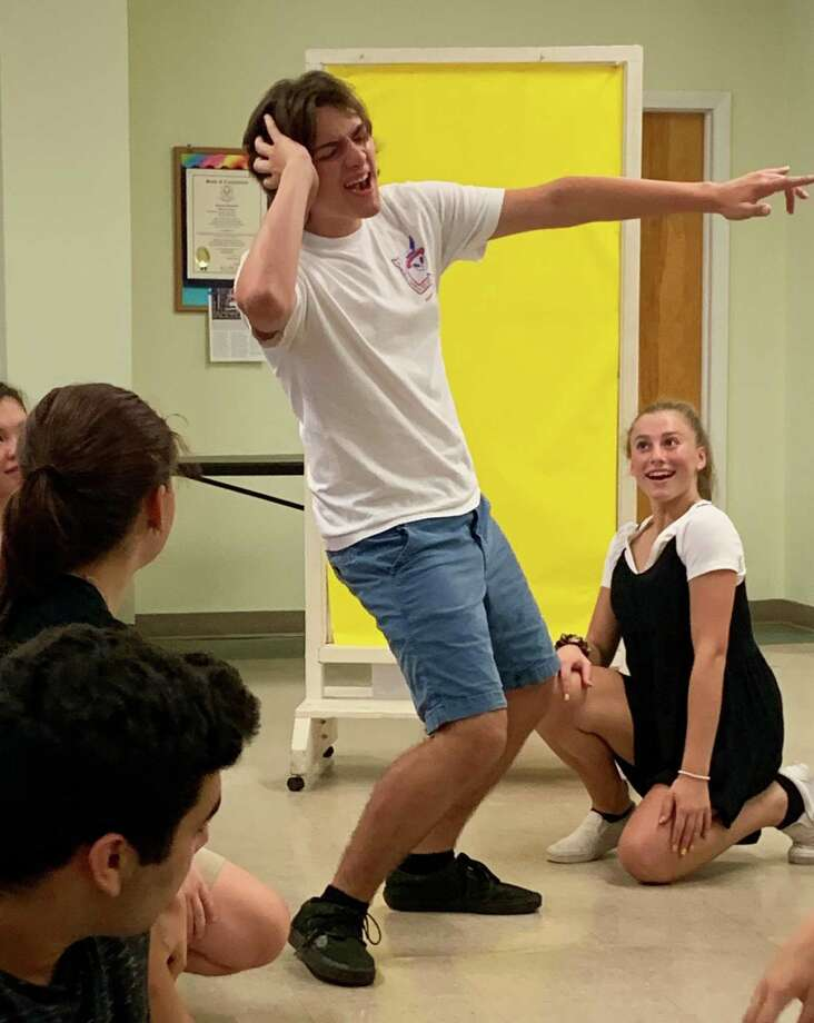 "Jim McMahon, of Trumbull, as Wade ""Cry-Baby"" Walker, and Alaina McCarvill, of Milford, as Wanda, rehearsing for the Pantochino Summer Teen Theatre staging of the musical ""Cry-Baby"" at the Milford Arts Council for three performances Aug. 9-11. Photo: Pantochino Summer Teen Theatre / Contributed Photo"